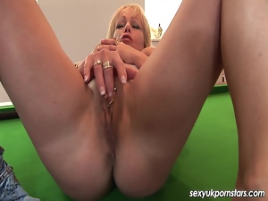 Mature British blonde masturbates on a pool table