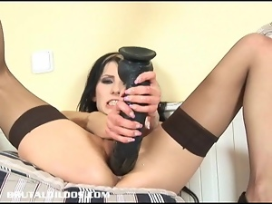 Vicky swallows a big dildo with her dripping wet pussy