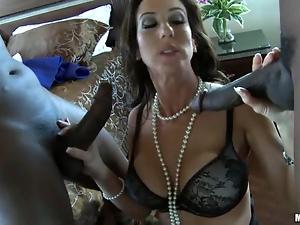 Brunette MILF in lingerie takes two black dicks