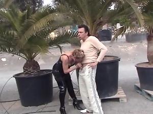 Dirty MILF sucks him off in public