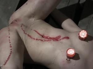 Bondage babe endures candle wax treatment