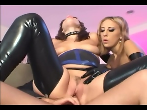 Two girls in latex lingerie and gloves fucking