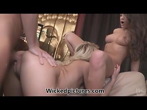 Teal Conrad and Annika Albrite sharing a shaft