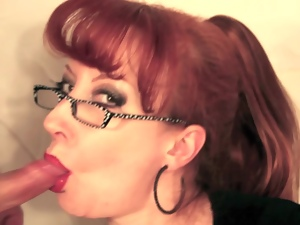 Mature spectacled redhead sucking cock