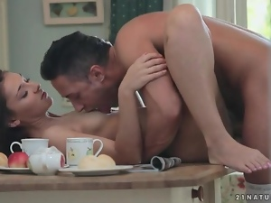 Erotic kitchen table fuck with a brunette
