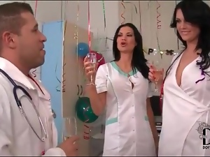 Sexy nurses kiss sensually and suck on toes