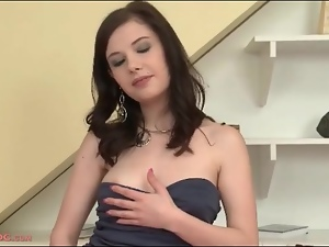 Teen in a slutty dress does a striptease