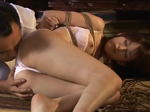Tied up Japanese girl fucked by dildo