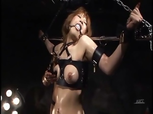 Babe put in erotic bondage and coated in oil