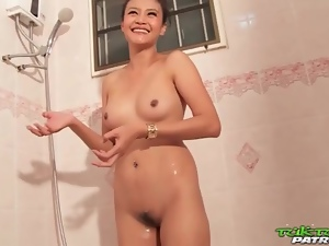 Beautiful young Asian washes her body in shower