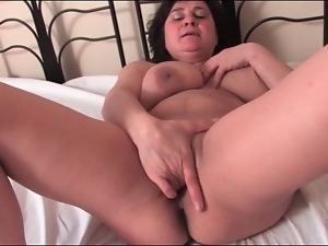 Mature brings out her big tits and masturbates