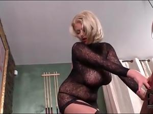Voluptuous blonde in black lace lingerie teases