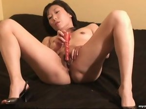 Vibrator arouses her young Asian pussy