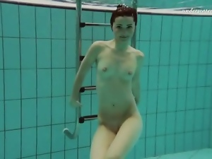Talented swimmer is naked underwater