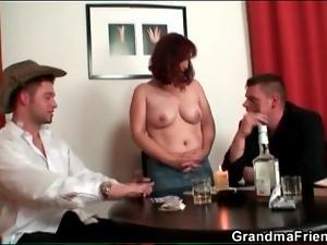 Mature loses at strip poker and gets naked