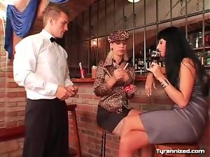 Smoking girls dominate the waiter at the bar