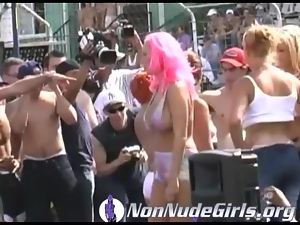 Girls on stage at wet tshirt contest