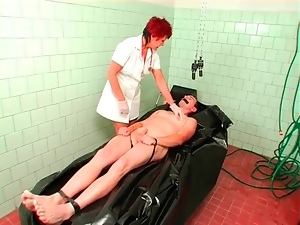 Man in body bag abused by sexy mature nurse