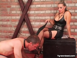 Licking toes of sexy girl in leather and stockings