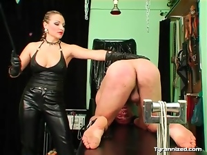 Mistress abuses his ass with her riding crop