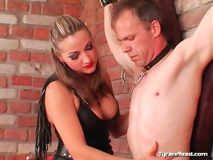 Lipstick and leather mistress dominates a guy