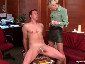 She binds his cock and balls and pours hot wax