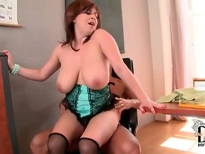 Her big tits bounce as she rides hard cock