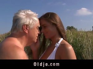 Busty young girl fucks grandpa on the beach