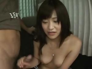 Shy girl gives a handjob in the van