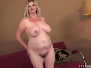 Fat girl fondles her mature tits in tease video