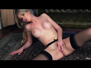 Stockings and garter belt on masturbating babe