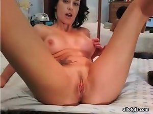 Tattooed camgirl with great tits masturbates