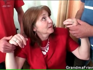 Classy mature business babe sucks two dicks