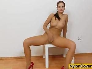 Brunette rides dildo in panty-hose