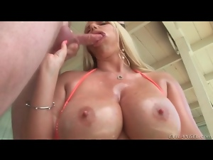 Big boobs blonde milf gives a wet titjob