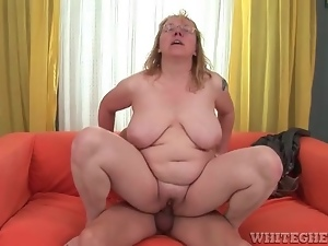 Mature in glasses rides cock and moans