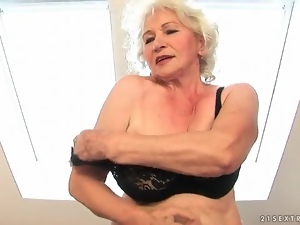 Granny strips from dress to rub her pussy