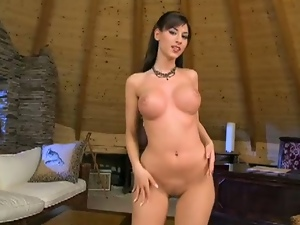 Lovely brunette with big tits masturbates and toys