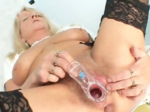 Horny grandma toys her old cunt
