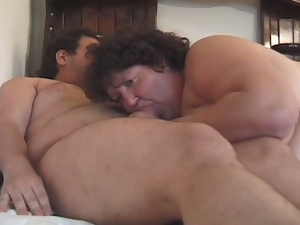 Old and fat life guard pounded by a younger man