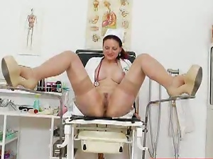 Redheaded nurse toys her cunt