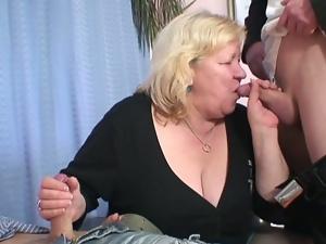 Big grandma takes two big cocks