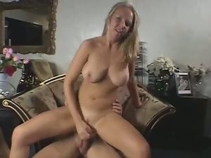 Busty blonde milf strokes cock