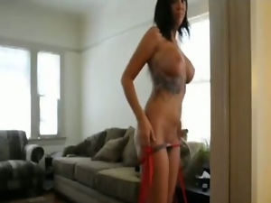 Busty tattooed amateur in action