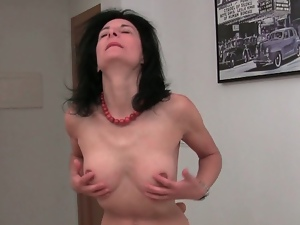 Attractive mature plays with her bush