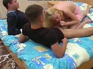 Blonde russian student sucks two cocks