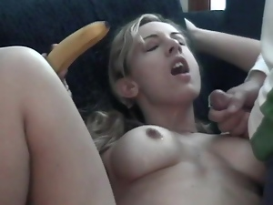 Pigtailed blonde toys her cunt with a banana in the presence of her BF