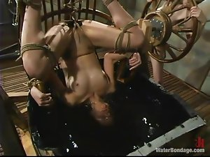 Slender Carly gets toyed with a strap-on under the water