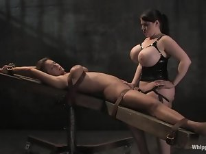 Mistress with huge tits is torturing this kinky blondie
