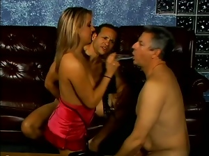 Desire Moore uses a strapon while having sex with two bisexual men